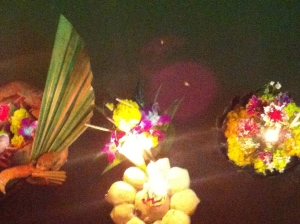 Handmade floating flower arrangements with a candle and a prayer.